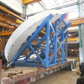 Shipping stand holding over-sized load